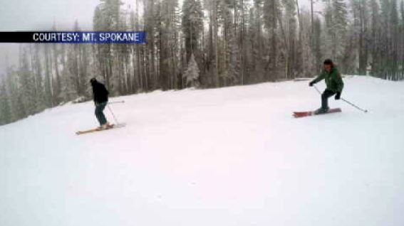 Skiers and snowboarders brave the rain for new chairlift, runs at Mt. Spokane