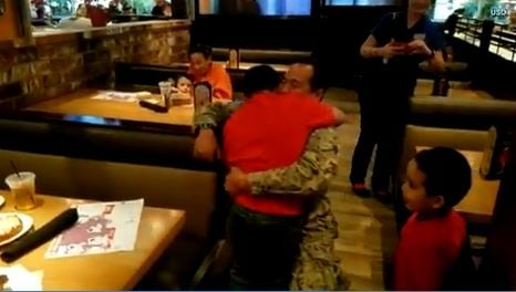 8-year-old boy cries as Navy dad surprises him at restaurant