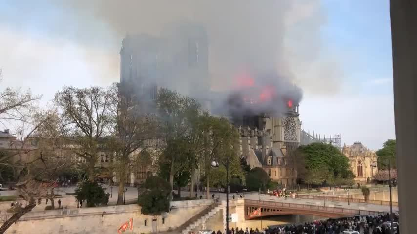 "Fire causes extensive damage to Notre Dame, Macron vows ""we will rebuild"""
