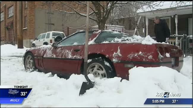 Parking rules enforced despite snow-stuck cars