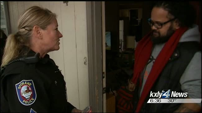 Police officers help family with Christmas gifts