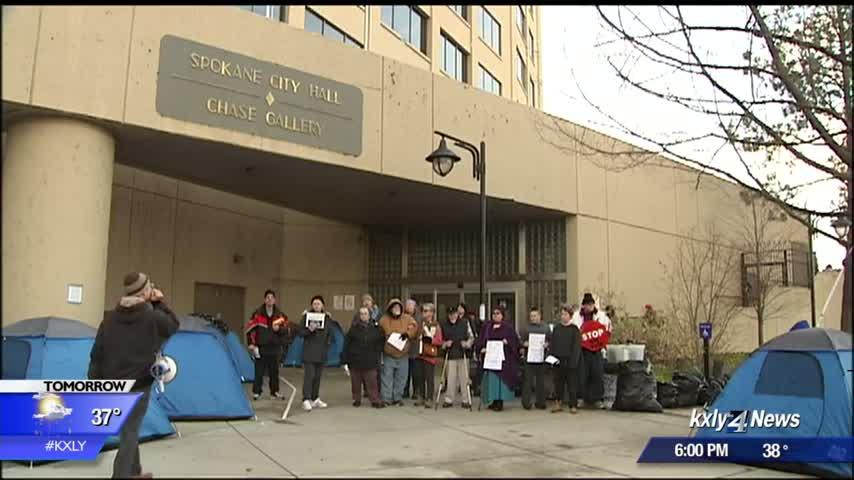 Protesters gather outside city hall, council says shelter beds are on the way