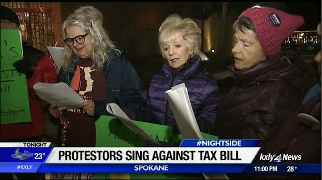 Protesters sing carols of concern for GOP tax plan