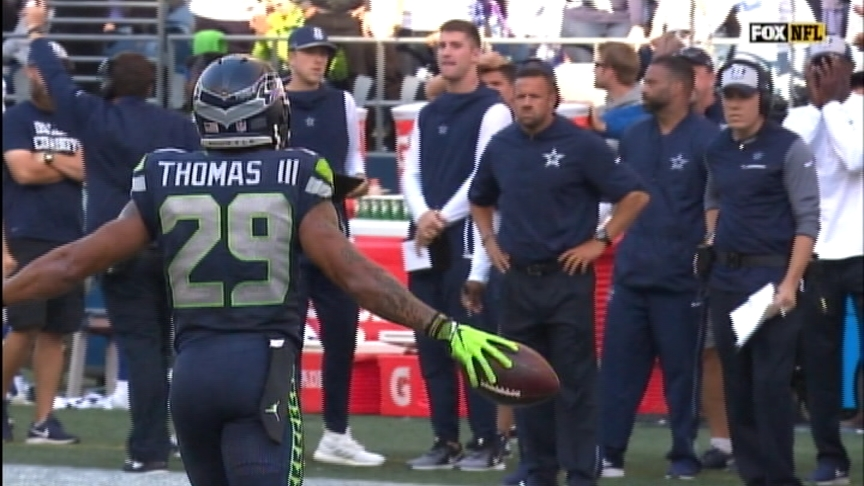 Wilson 3 TDs, Thomas 2 picks, Seahawks beat Cowboys 24-13