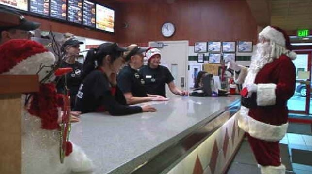 Santa delivers donations to fast food employees working Christmas Eve