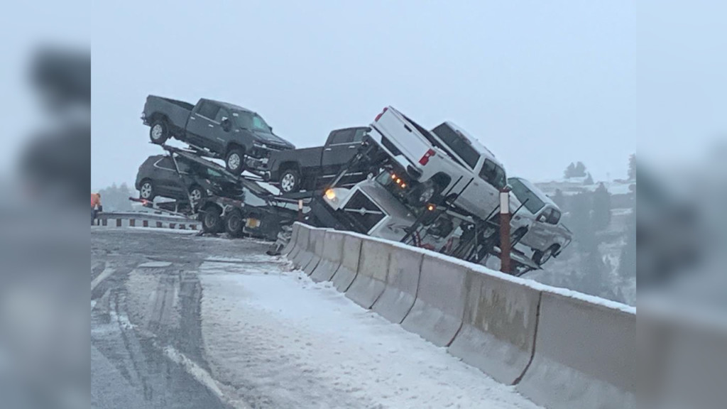 Semi carrying multiple cars teetering on side of Highway 195 near Colfax, driver out safe