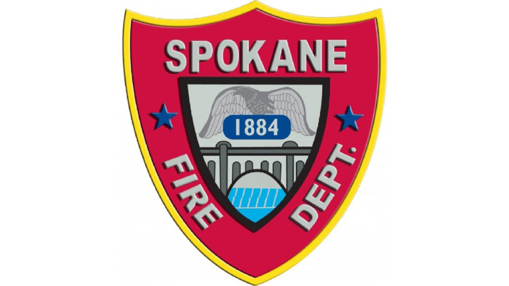 Firefighter suffers minor injuries, woman detained after house fire