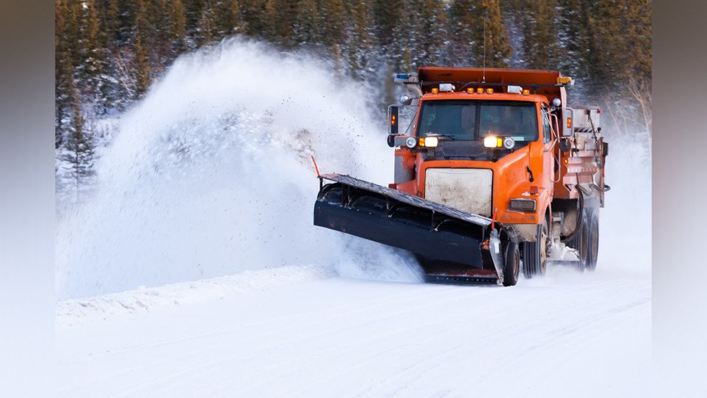 Snowplow plowing snow