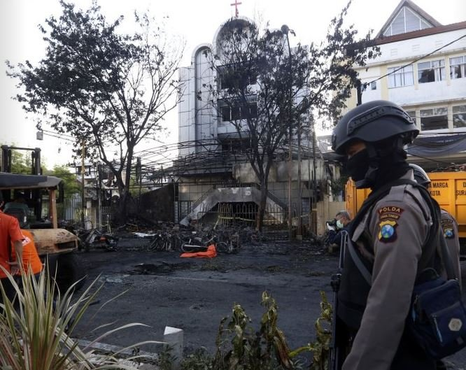 Police: Members of a family bombed 3 Indonesian churches