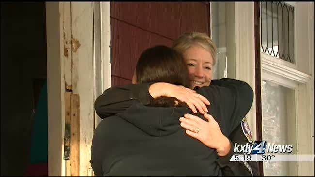 Spokane police officer delivers early Christmas gifts