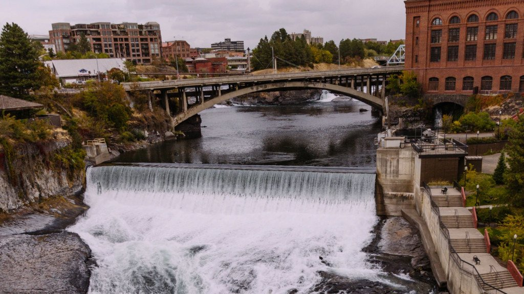 New plaza opens up on the Spokane River, houses overflow tank underneath it