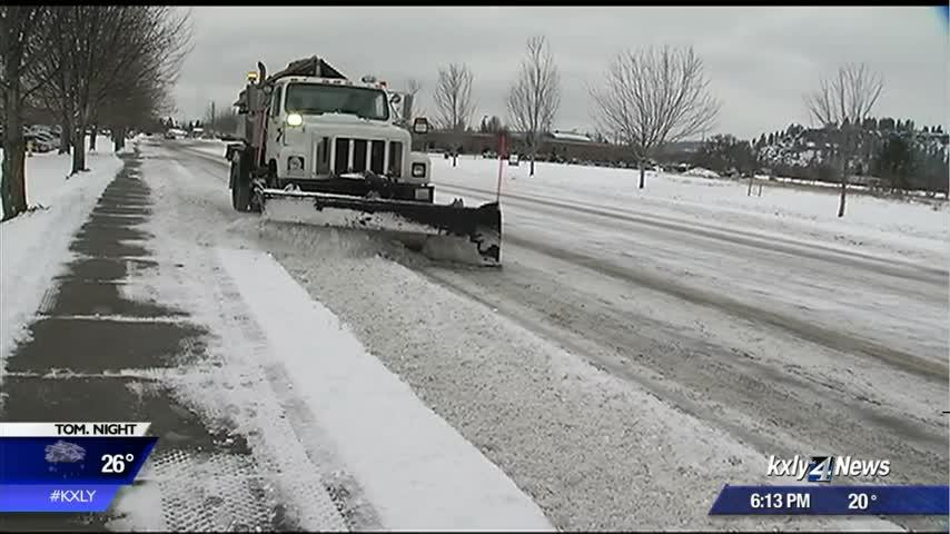 Road crews work around the clock to clear roads as snow continues to fall