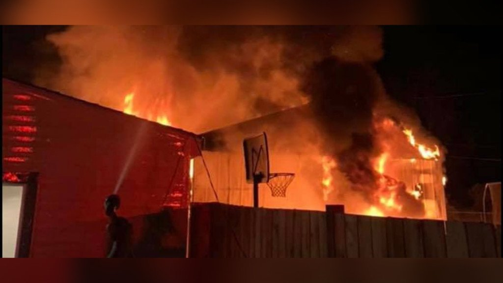 Fire ignites propane tanks in northeast Spokane garage; firefighters contain the flames