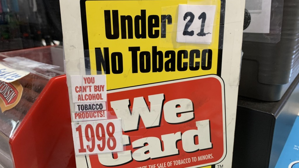 Tobacco sign changes to say no sales to anyone under 21