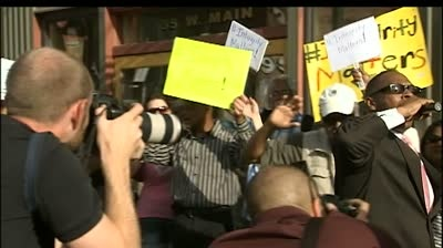 NAACP members rally in solidarity following Dolezal resignation