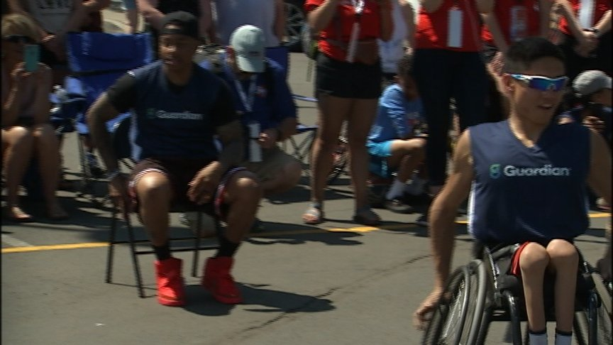 Isaiah Thomas plays HORSE at Hoopfest with Spokane parasport athlete