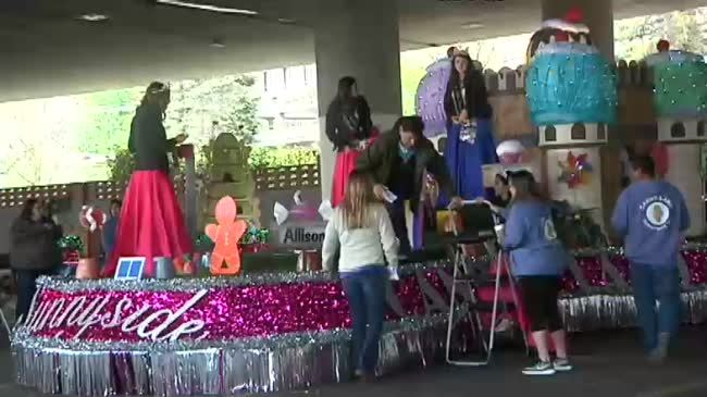 Volunteers make final preparations for the 79th Torchlight Parade