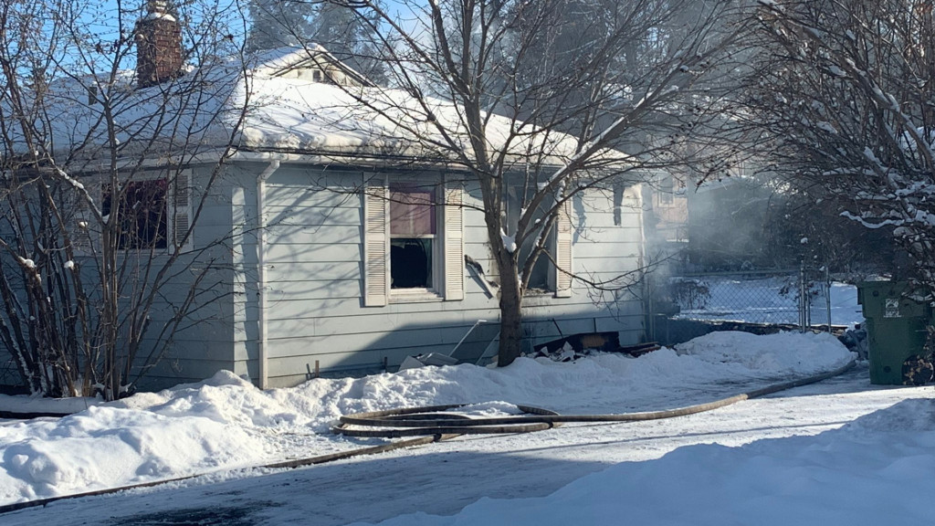 Firefighters clear out a house fire on 16th Avenue.