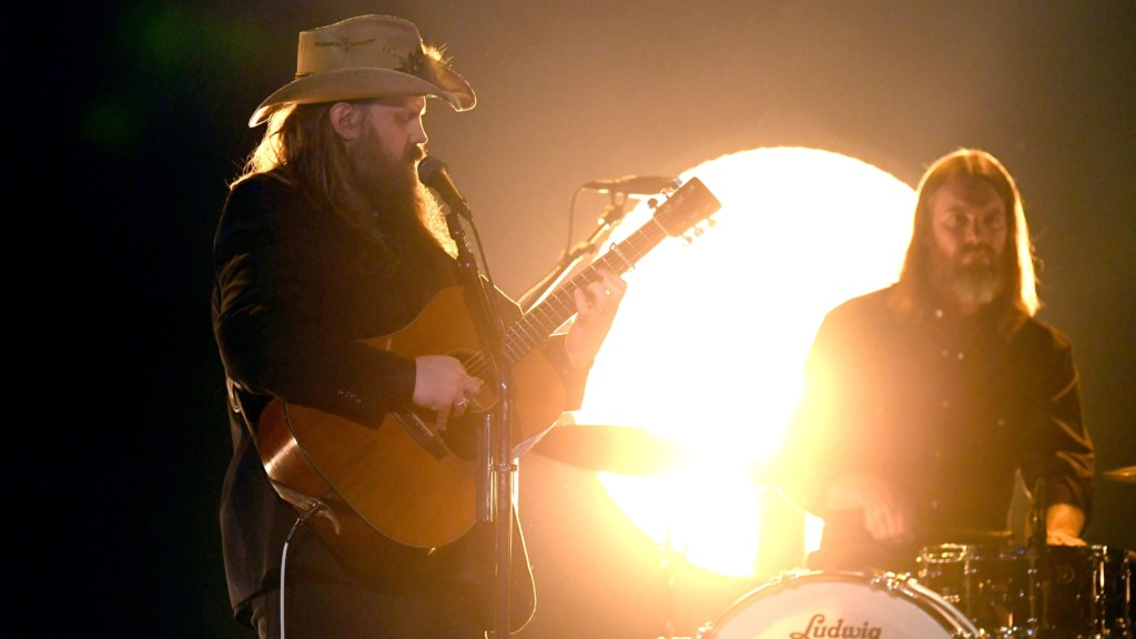 Chris Stapleton plays guitar on stage