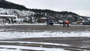 Rescuers search Silver Mountain by helicopter.