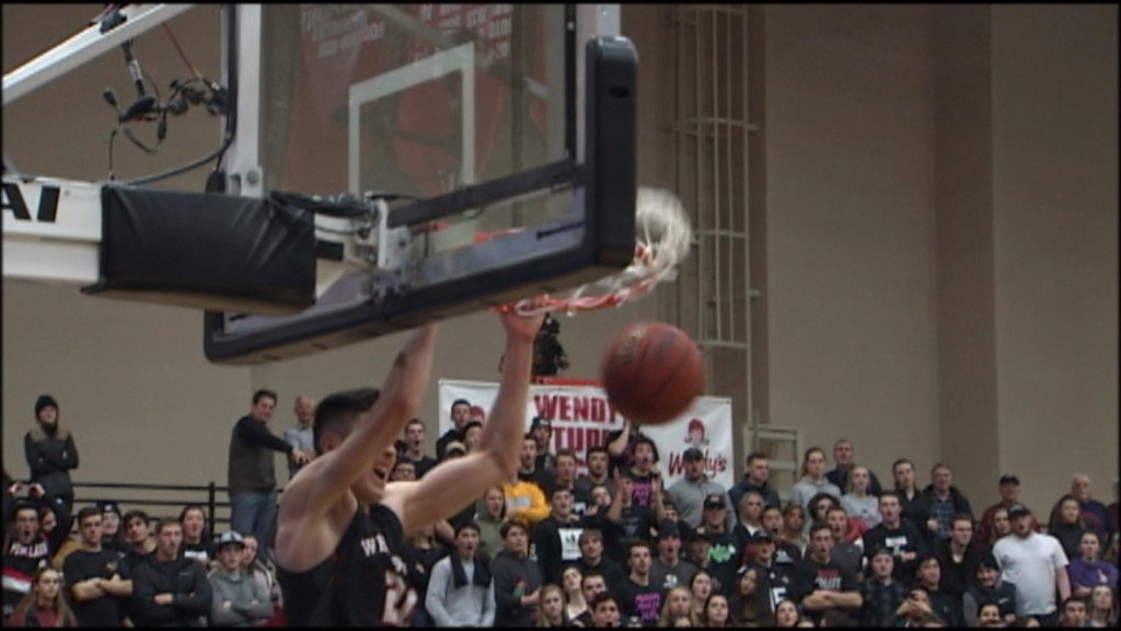 Whitworth Pirate Liam Fitzgerald dunks the ball against Whitworth