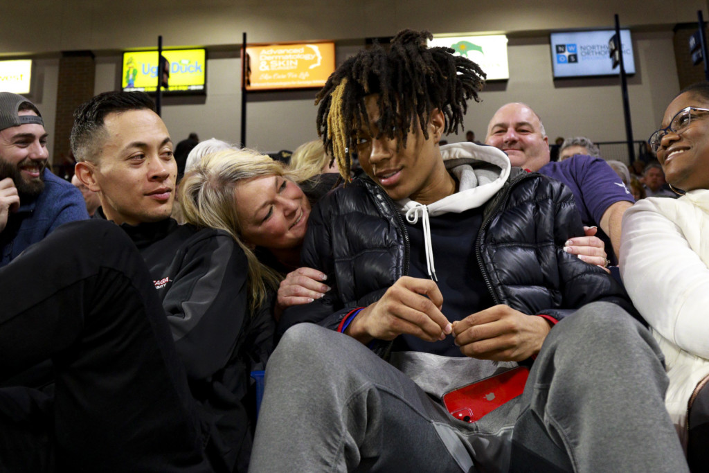 4-star Guard Hunter Sallis listens to a Gonzaga fan while watching the game against Pacific.