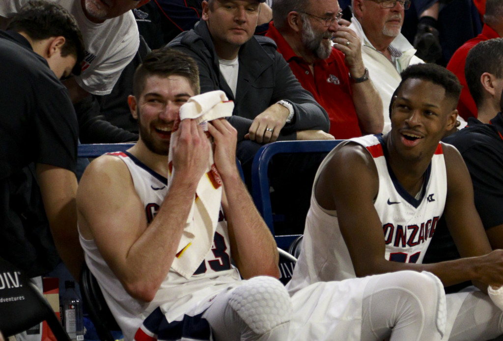 Gonzaga's Killian Tille and Joel Ayayi share a laugh on the bench during the game against Pacific. Gonzaga won 92-59.