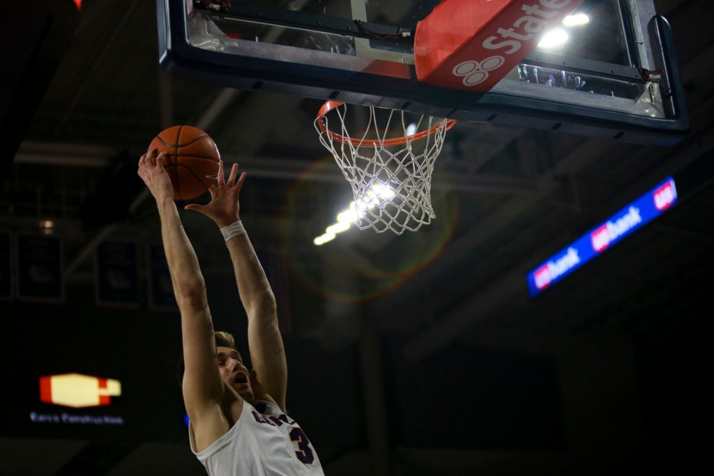 Gonzaga's Filip Petrusev with the two-handed slam against Pacific. Petrusev finished the night with 15 points.