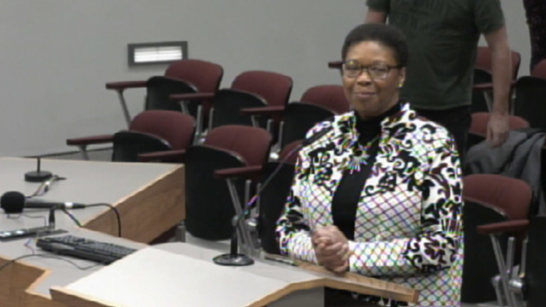 Betsy Wilkerson speaking at her inaugural council meeting.
