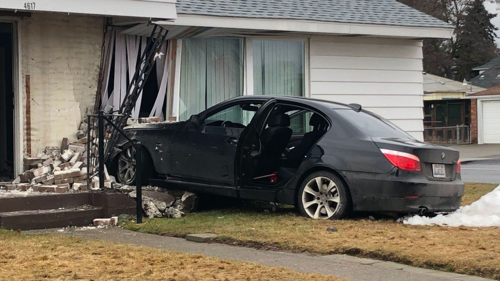 Car crashes into North Spokane home.