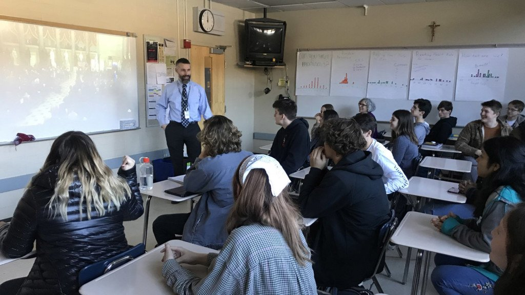 Gonzaga Prep students watch Gleason's Congressional Gold Medal ceremony in class.