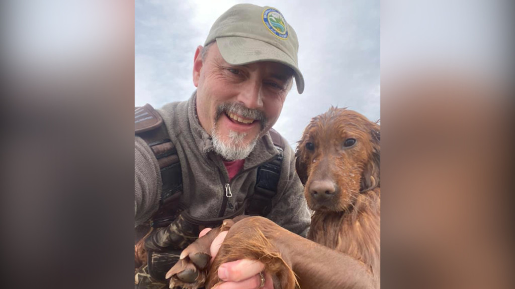 Eric Braaten with the dog he rescued.