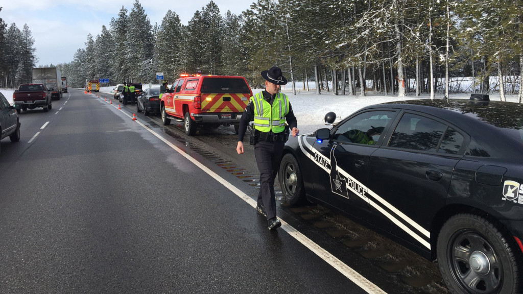 ISP Troopers are parked along the shoulder of westbound I-90 to investigate a crash.