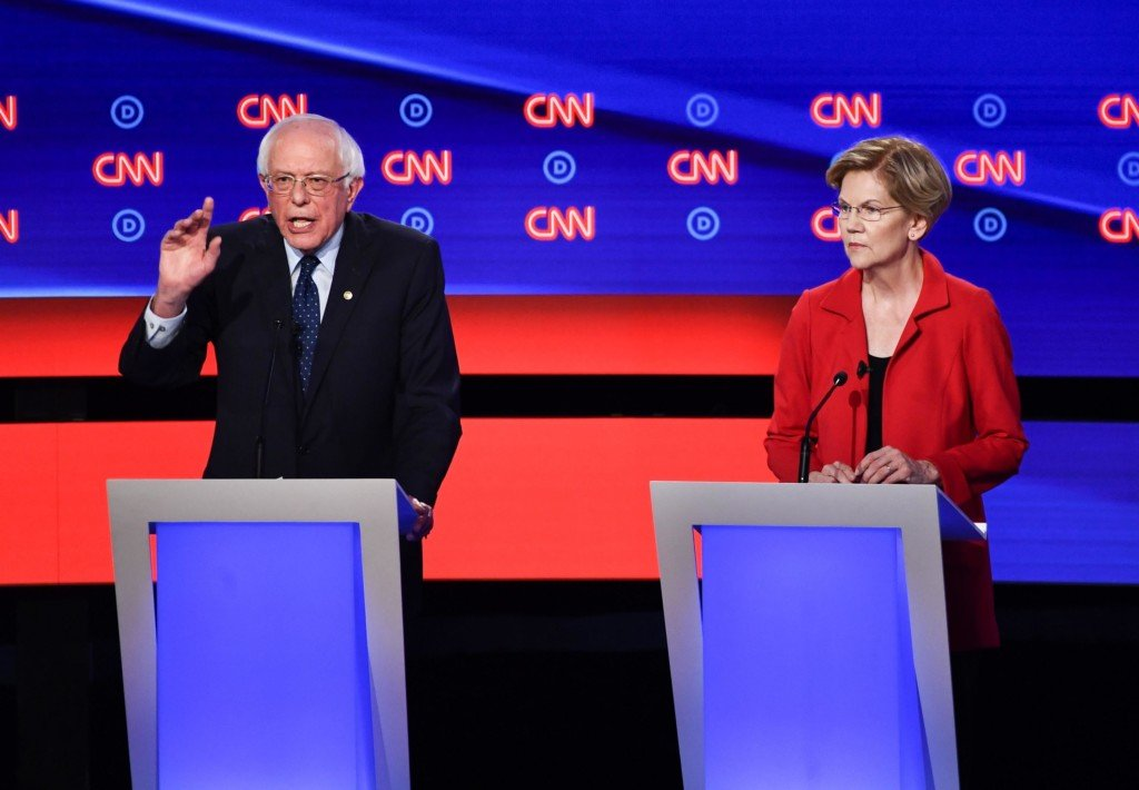 Democratic presidential hopefuls US senator from Vermont Bernie Sanders and US Senator from Massachusetts Elizabeth Warren participate the first round of the second Democratic primary debate of the 2020 presidential campaign season hosted by CNN at the Fox Theatre in Detroit, Michigan on July 30, 2019