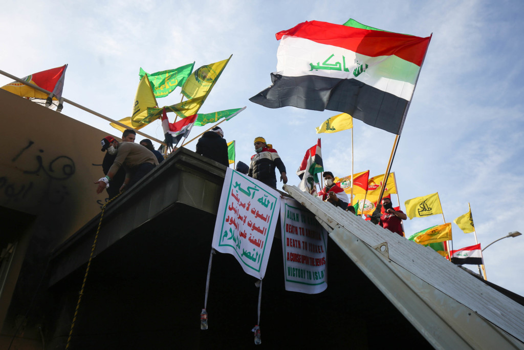 Supporters and members of the Hashed al-Shaabi paramilitary force gather during a demonstration outside the US embassy in the Iraqi capital Baghdad on January 1, 2020