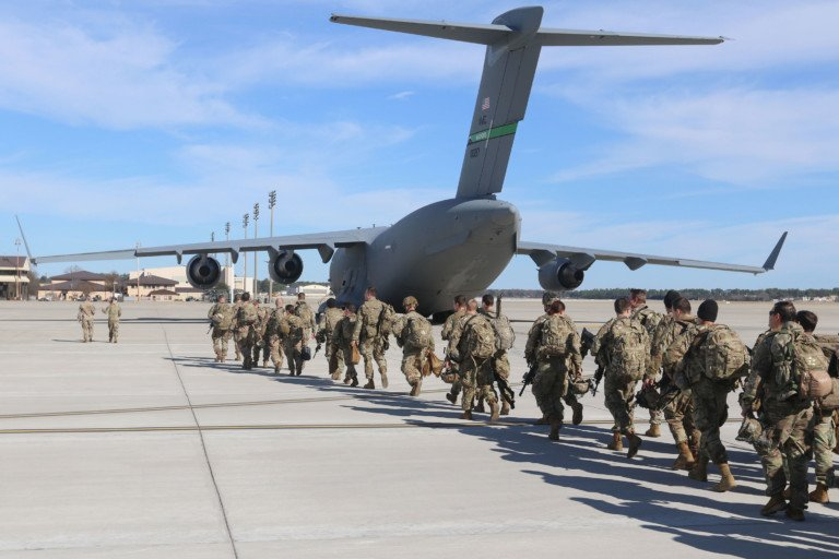 Soldiers from the 82nd Airborne Division prepare to deploy from Pope Army Airfield.