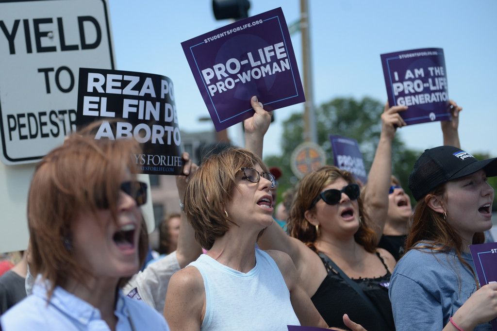 Women yell cadences in support during a pro-life rally outside the Planned Parenthood Reproductive Health Center on June 4, 2019