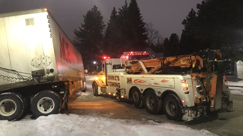 Tow crews freeing a jackknifed semi from the Huckleberry's parking lot.