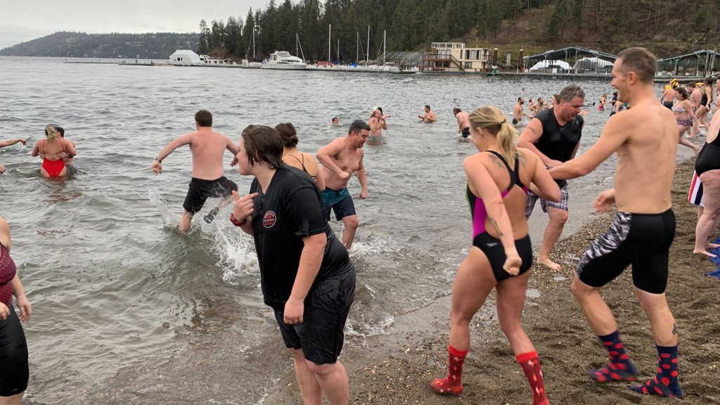 People brave cold water at Lake Coeur d'Alene