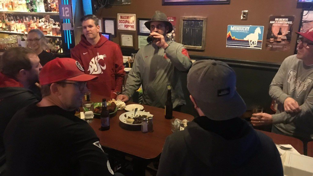 WSU football coach Nick Rolovich treats fans to a round of beers.