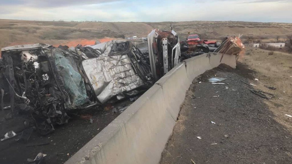 A semi crashed and dumped several crushed cars along Highway 17.