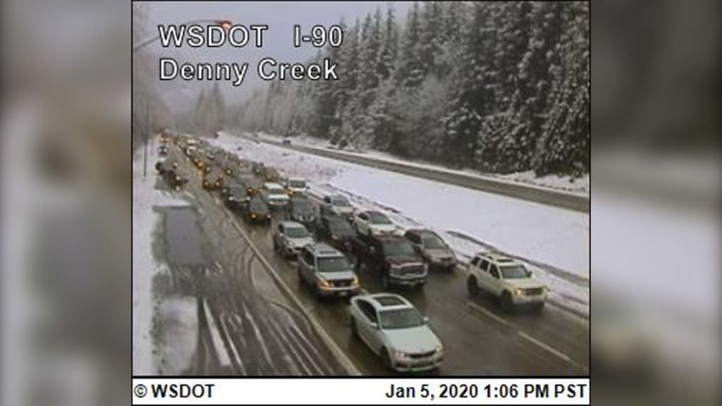 Snowy conditions are seen on I-90 near Snoqualmie Pass