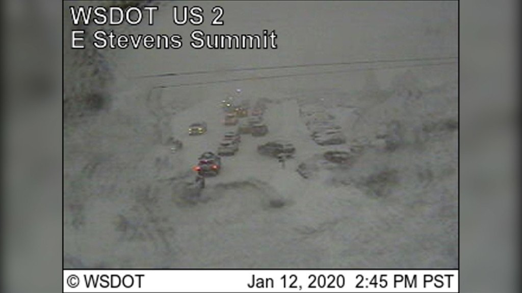 WSDOT traffic cams showing cars trying to navigate the heavy snowfall.