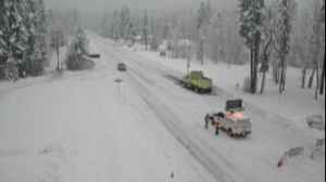 Highway 2 is closed over Stevens Pass due to snow and downed trees.