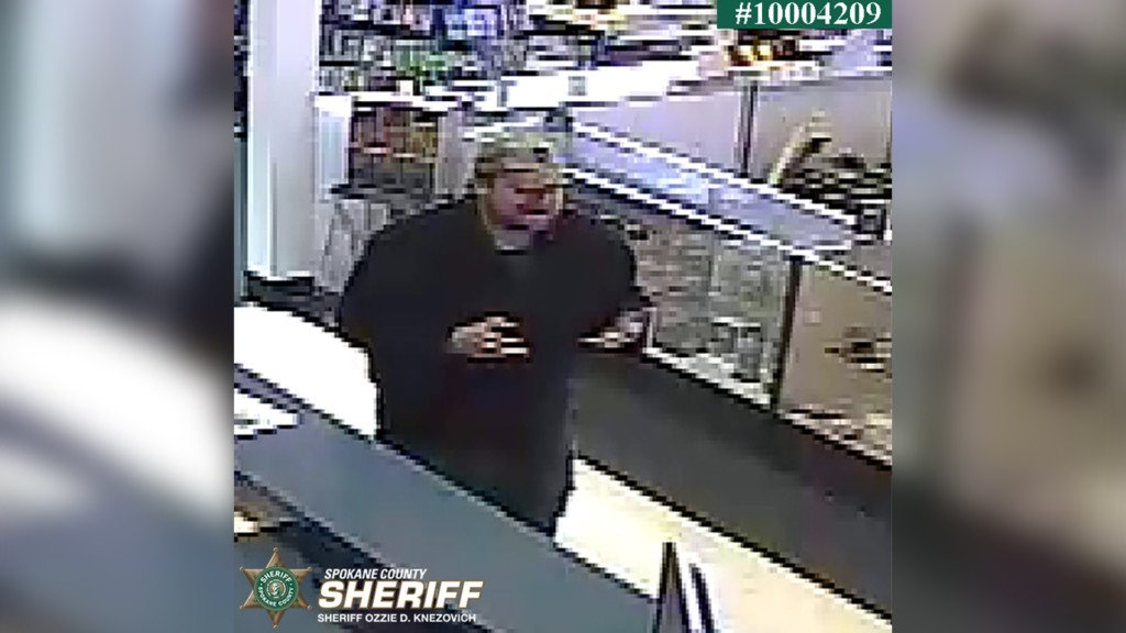 Security footage from the pawn shop, showing the suspect.