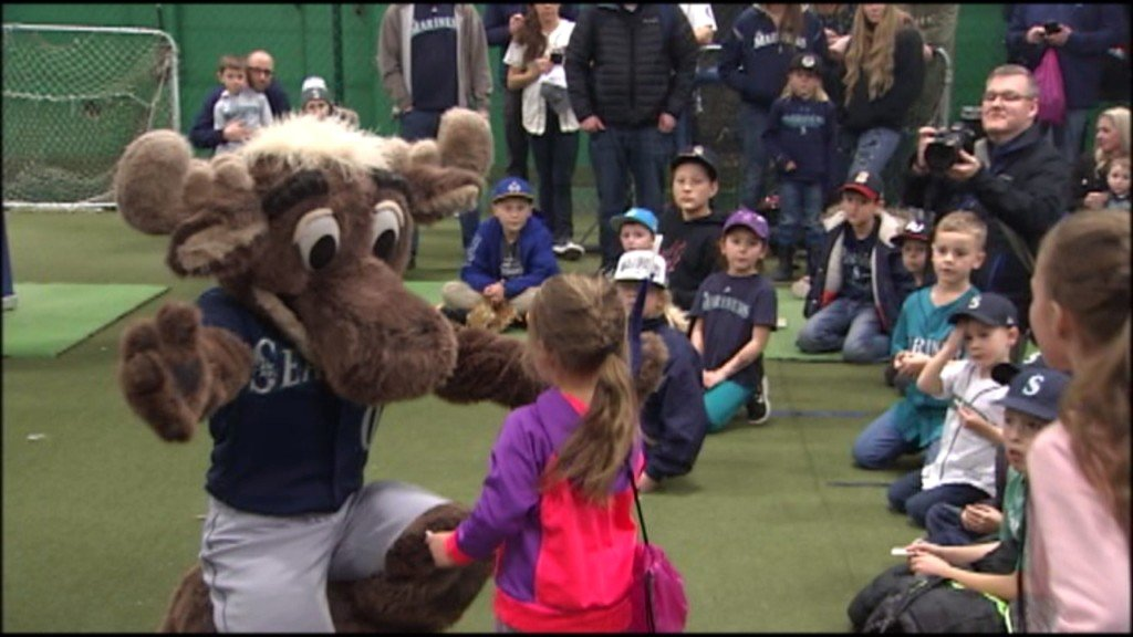 The Mariners Moose giving a hug to a young fan in Spokane