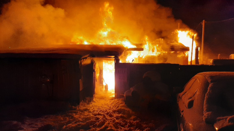 A house engulfed in flames in Weippe.