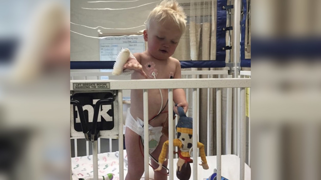 Owen in the hospital with his Woody toy.