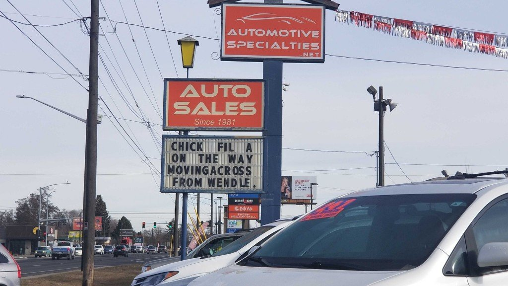 Automotive specialties sign reads announces chick-fil-a site