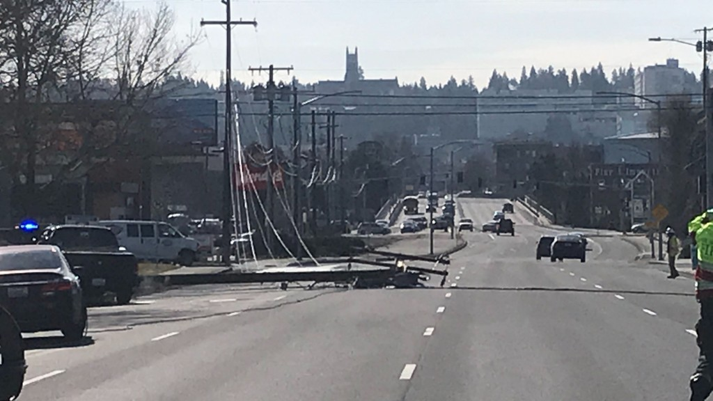 An electrical explosion brings down a powerpole on Division